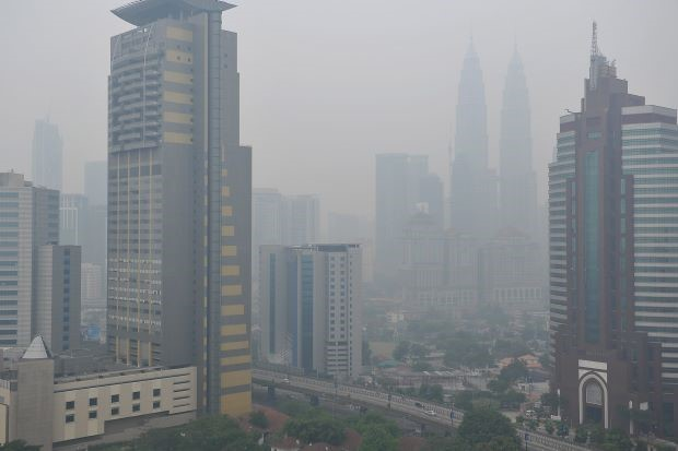 Air quality was at unhealthy levels in nine areas as of 8 am, Tuesday. (Photo by BERNAMA)