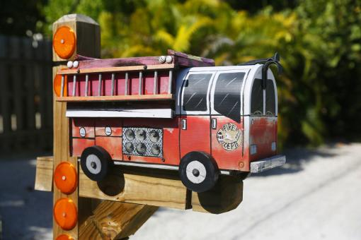 A mailbox in the shape of a fire truck is seen along the highway US-1 in the Lower Keys near Marathon in Florida, July 11, 2014. (REUTERS/Wolfgang Rattay)