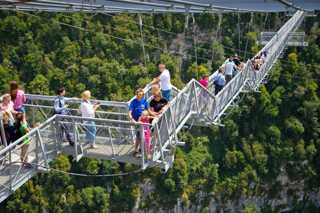Don't look down: Pedestrians on the bridge cross a 500ft drop. (CEN)