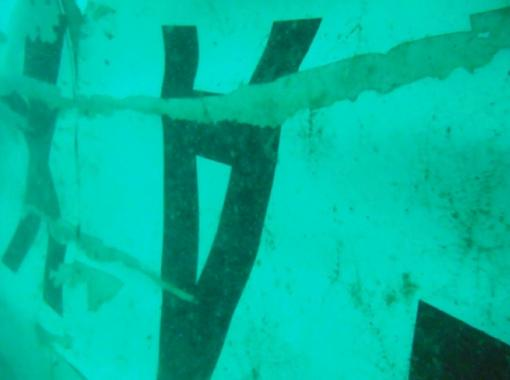 In this undated underwater photo released by Indonesia's National Search And Rescue Agency (BASARNAS) on Wednesday, Jan. 7, 2015, the part of the wreckage that BASARNAS identified as of the ill-fated AirAsia Flight 8501 is seen in the waters of the Java Sea, Indonesia. Divers and an unmanned underwater vehicle spotted the tail of the missing AirAsia plane in the Java Sea on Wednesday, the first confirmed sighting of any major wreckage 11 days after Flight 8501 disappeared with the passengers and crew members on board. (AP Photo/BASARNAS)
