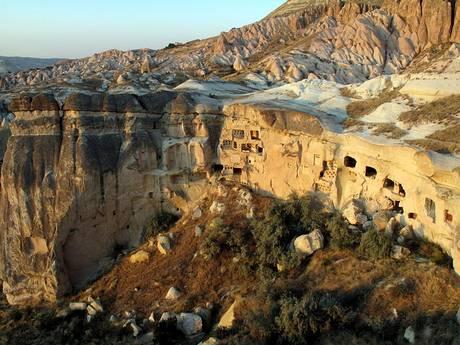 Cappadocia's characteristic volcanic rock landscape lends itself to underground cities