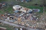 This aerial photo shows storm damage of the River Oaks Mobile Home Park in Sand Springs, Okla., on Thursday, March 26, 2015. The first batch of severe weather in this year's tornado season devastated the mobile home park, as storms across the area damaged buildings, tore off roofs and left debris strewn across roads. (AP Photo/Tulsa World, Tom Gilbert)
