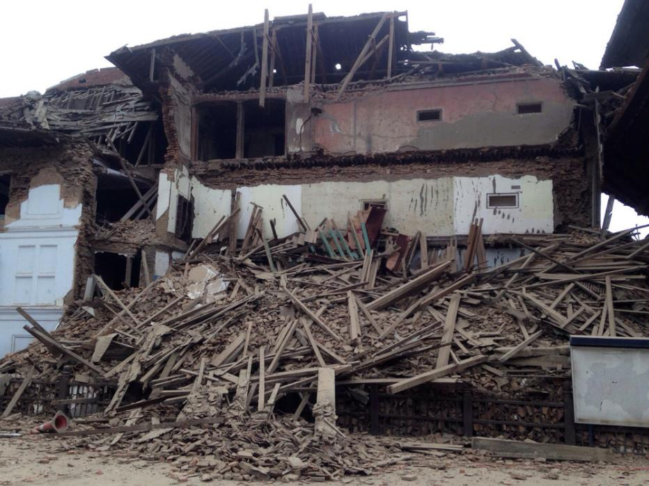 A building stands damaged after an earthquake in Kathmandu, Nepal, Saturday, April 25, 2015. A strong magnitude-7.9 earthquake shook Nepal's capital and the densely populated Kathmandu Valley before noon Saturday, causing extensive damage with toppled walls and collapsed buildings, officials said. (AP Photo/ Niranjan Shrestha)