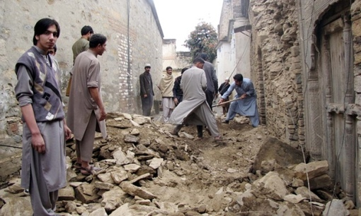 Roads and buildings destroyed by the earthquake in Swat, Pakistan. Photograph: ppiimages/Demotix/Corbis