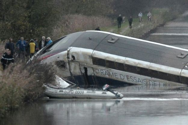 Rescuers work at the scene where a high-speed TGV train coach and engine carriage lie in a canal in Eckwersheim near Strasbourg, northeastern France, after derailing on November 14, 2015