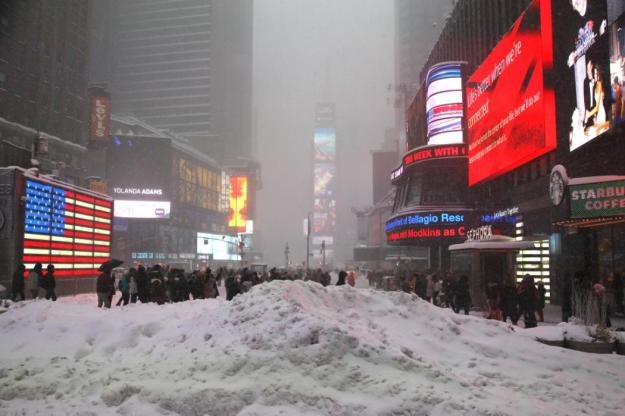 People take photos in Times Square as the snow gets heavier during a large winter storm in New York City, Jan. 23, 2016. (Gordon Donovan/Yahoo News)