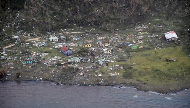 The damage to Mudu village on Koro Island after the most powerful cyclone in Fiji's history battered the Pacific island nation (AFP Photo/)