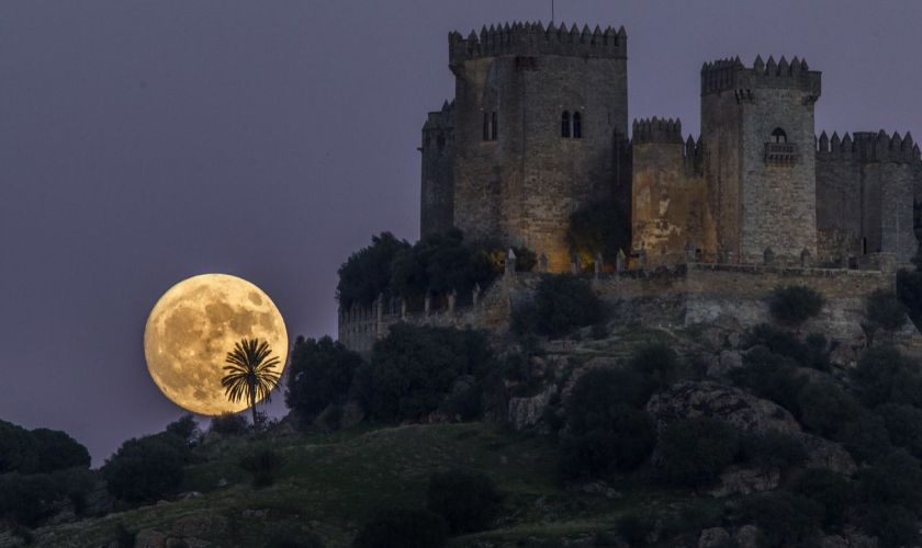 The moon rises behind the castle of Almodovar in Cordoba, southern Spain. (AP Photo/Miguel Morenatti)