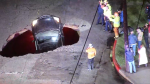 Laurel Canyon Boulevard was partially back open to traffic Monday, Feb. 20, 2017, after a sinkhole opened up and swallowed two cars during a monster storm three days earlier. No serious injuries were reported. (Photo credit to KNBC-TV)