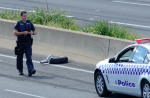 Melbourne's Tullamarine Freeway was declared a crime scene as what appears to be one of the wheels from the plane came to rest on the roadway. Photo: AAP