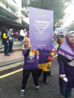 A protester holding up a poster demanding for equality in marriage.
