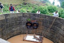 Between a Rock and a Hard Place: The image tells an inspirational story of a leopard that fell into a well in Nashik, Maharashtra, where it swam for an incredible 30 hours before being discovered alive, but barely. The cat would undoubtedly have died had it not been for local villagers, who once informed, swung instantly into action by alerting and pitched in to help forest officials. Using the remarkable ingenuity for which rustic people in India are renowned and at great risk to life and limb, villagers and officials worked in unison against all odds to save the leopard.