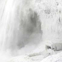 TOPSHOT - Ice coats the rocks and observation deck at the base of the Horseshoe falls in Niagara Falls, Ontario on January 3, 2018. The cold snap which has gripped much of Canada and the United States has nearly frozen over the American side of the falls. / AFP PHOTO / Geoff Robins (Photo credit should read GEOFF ROBINS/AFP/Getty Images)