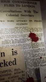 Laporan akhbar tentang serangan pengganas ke atas balai-balai polis di Tanah Melayu.
